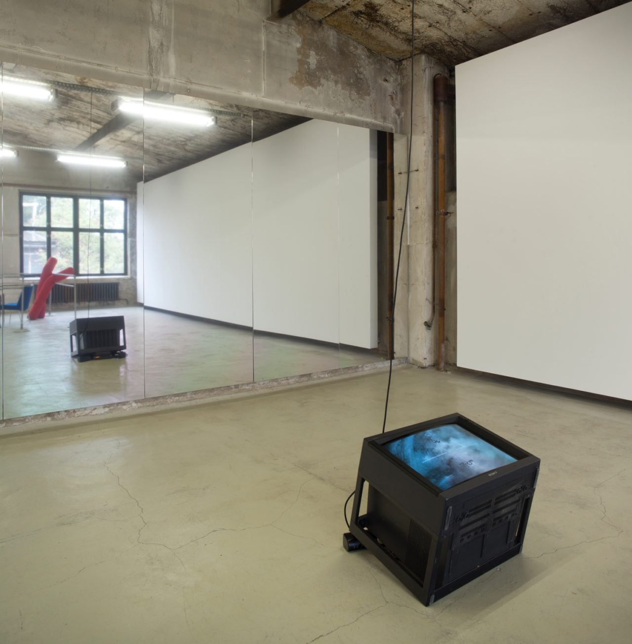 Wall: Heimo Zobernig, untitled (2000); Floor: Christoph Büchel, AC-130 gunship targeting video (2004)