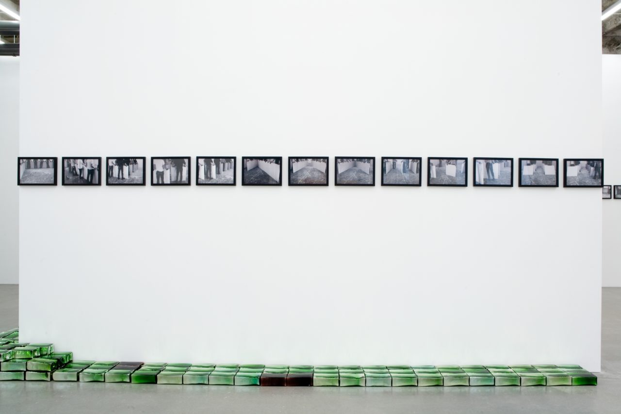Wall: Santiago Sierra, 111 constructions with 10 modules and 10 workers (2004); Floor: Pae White NoéNoé II (2003)