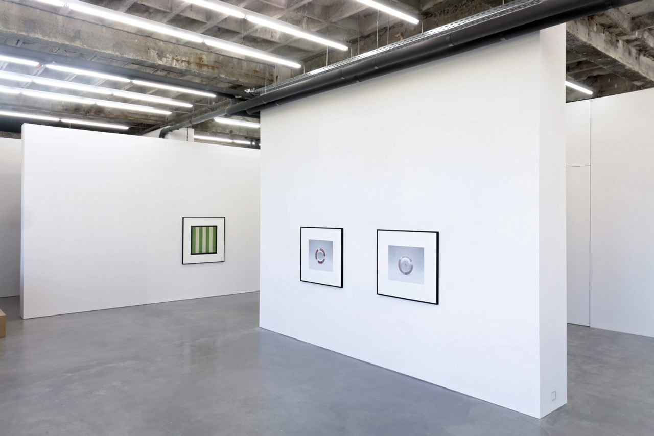 Left: Christopher Williams, One of 406 ceiling panels (23 3/4 × 23 3/4 inches each) [...] (2006); Right: Christopher Williams, Afri-Cola (ashtray) [...] (2005)